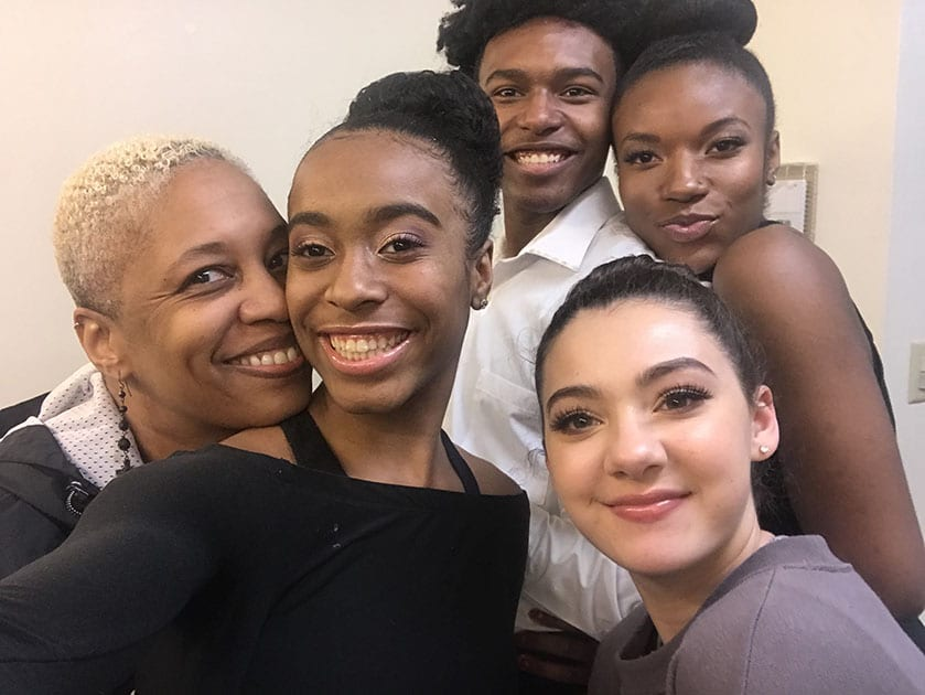 Greer Reed and her dance students smiling together